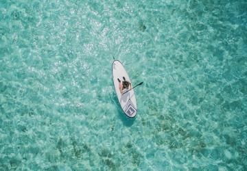 paddleskie in crystal clear sea water