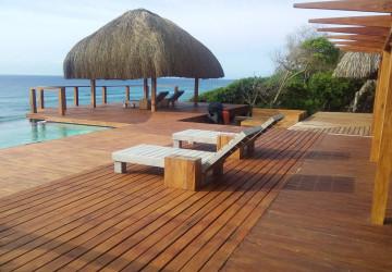 swimming pool and thatched gazebo overlooking ponta mamoli beach